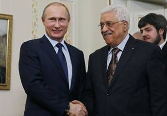 Russian President Vladimir Putin (L) shakes hands with his Palestinian counterpart Mahmud Abbas during their meeting at the Novo-Ogaryovo residence outside Moscow on April 13, 2015. (Photo credit: AFP/ POOL / SERGEI ILNITSKY)